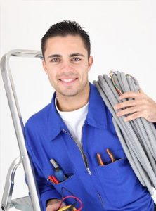 electrician holding wires fully equipped