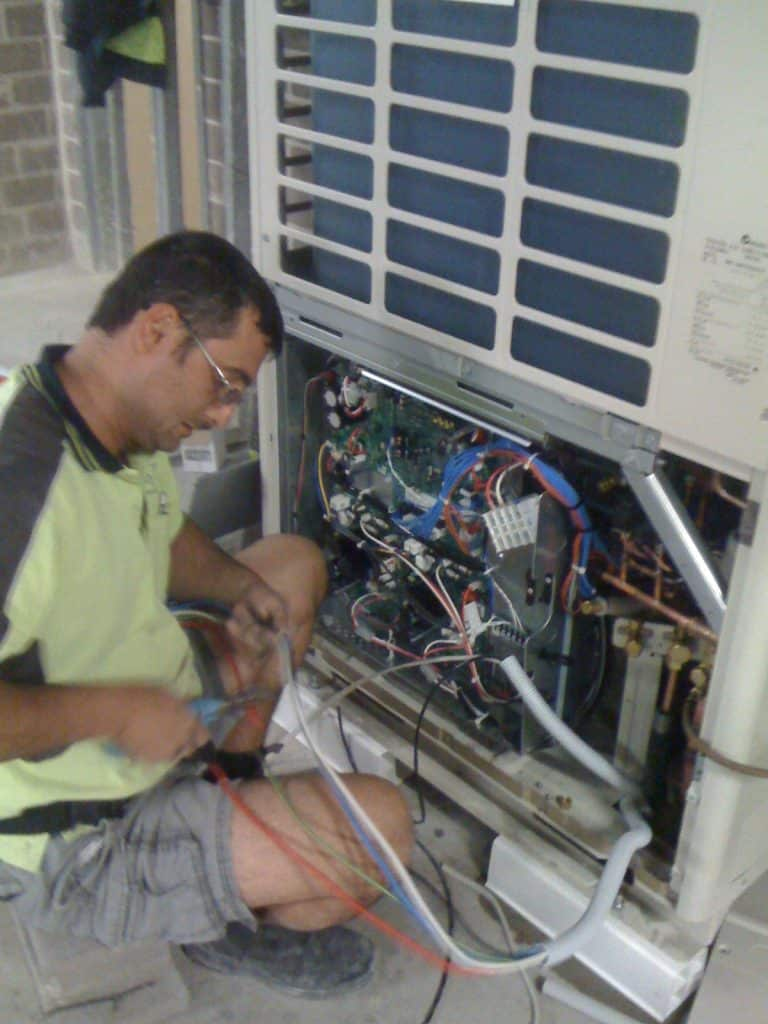 electrician servicing air con